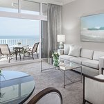 Two-bedroom suite features a queen sleeper sofa and private balcony or terrace