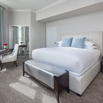 Two-bedroom suite features a master bedroom with a king-sized bed and full master bath