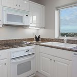 Two-bedroom suite features a fully equipped kitchen