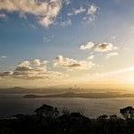 View of the sun setting over Auckland City from Rangitoto Summit.