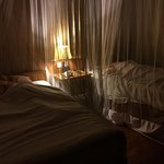 Mosquito nets over beds at night