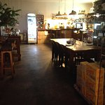 Inside Copoc - large wooden table, casual