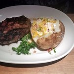 The rib steak comes with a baked potato after 5:00 pm