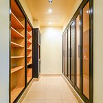 Huge walkin closet with plenty of cabinets