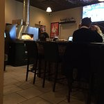 The bar and Pizza over - TV - to try to be a sports bar???
