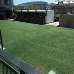 The lovely view of astroturf from my balcony. Turns into a bar on weekends.