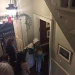 A housemaid shows us into Charles Dickens' writing room, where he wrote 'Oliver Twist'.