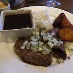Cuban steak with rice, black beans, and plantains