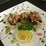 Blackened Scallops with coconut and black bean rice topped with fresh pico de gallo