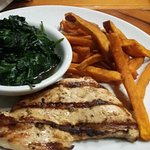 Grilled chicken breast with sauteed spinach and sweet potato fries