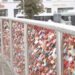 One of the pedestrian bridges over the river is filled with locks of love. Bicycle locks that is