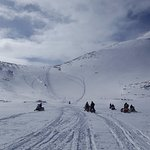 Snowmobiling in the Snowy Mountain Range
