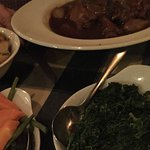 Coq au vin and vegetable sides.