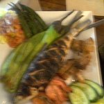 inihaw platter with eggplant,ensalada,grilled bangus fish and grilled pork liempo