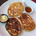 AMAZING gluten free pancakes with butter and syrup. Maybe the best pancakes I have ever had.