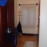 Hallway in room heading to bathroom