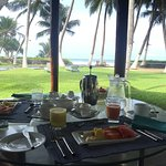 Enjoying our breakfast outside our room (facing the ocean)
