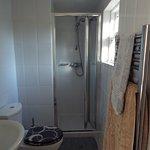 En-suite bathroom in Single room with bathroom window. Price £45 per night including breakfast.