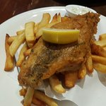 Halibut deep fried with batter and served with chips (RM52.00)