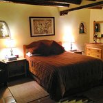 Foot thick adobe walls, natural wood viga ceiling, authentic southwest décor- Inn at Pueblo Boni