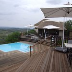 The deck, outdoor dining & infinity pool