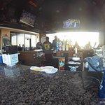at the bar, facing south