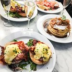 Eggs Benedict w/ bacon, Apple Pie Pancakes, Prosecco. Photo by @michelleenorman