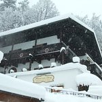 Haus am Berg in the snow