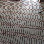 Interesting patterned carpet in room.