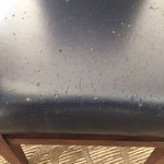 Worn faux weather on all dining chairs.