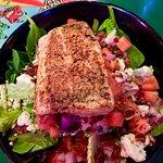 Mahi mahi atop a fresh green salad with bleu cheese.