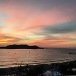 Beautiful sunset over Ixtapa Island (pier on R)