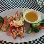 Gilled lobster with vegetables pasta or potatoes also included.