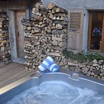 Take a dip in the outdoor hot tub on the chalet terrace