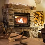 The huge fireplace gives the room a cosy atmosphere