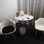 Plastic desk area with chairs - one rocks