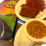 The ribs plate with baked beans and baked potato.