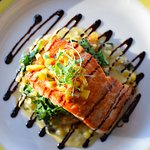 Salmon (lunch menu) monfongo de yucca, spinach, roasted corn poblano cream sauce, pineapple sals