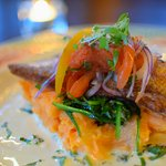Red Snapper (dinner) over red pepper mashed potatoes, cilantro butter sauce, fresh tomato relish