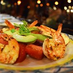 Loretto Salad - Grilled shrimp, heirloom tomatoes, grilled red onion, hearts of palm, avocado.