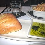 Warm bread with herbal olive oil