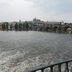 Peacful water flow of Moldau River turns to rapid flow near Smetana statue