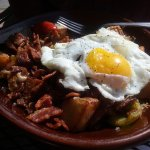 This is hubby's Sahara Skillet with over easy eggs and bacon crumbles. He shared bacon ... delis