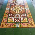 """Symbolic """"tiles carpet"""" to represent the millions of flowers and wreaths placed at the site"""