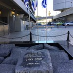 Monument to Prime Minister Rabin with brass markings on ground behind