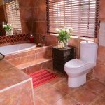 Guinea Fowl Bathroom offering double basins, bath and lovely large shower