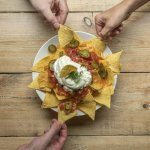 Share a plate of nachos with friends