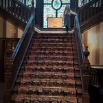 Impessive staircase and stained glass windows.