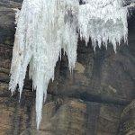 A bluff hanging frozen waterfall.