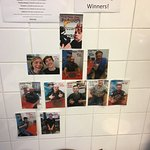 "the ""Pyro Challenge"" winners wall at Padrino's. A spicy food challenge that is tons of fun!"